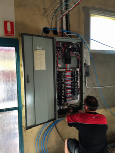 man completing power board building